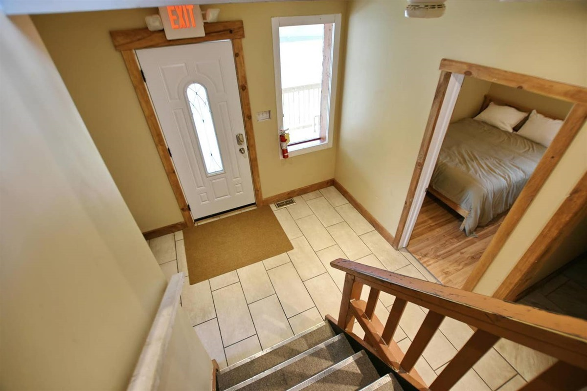 Looking down from staircase to the main entrance & hallway
