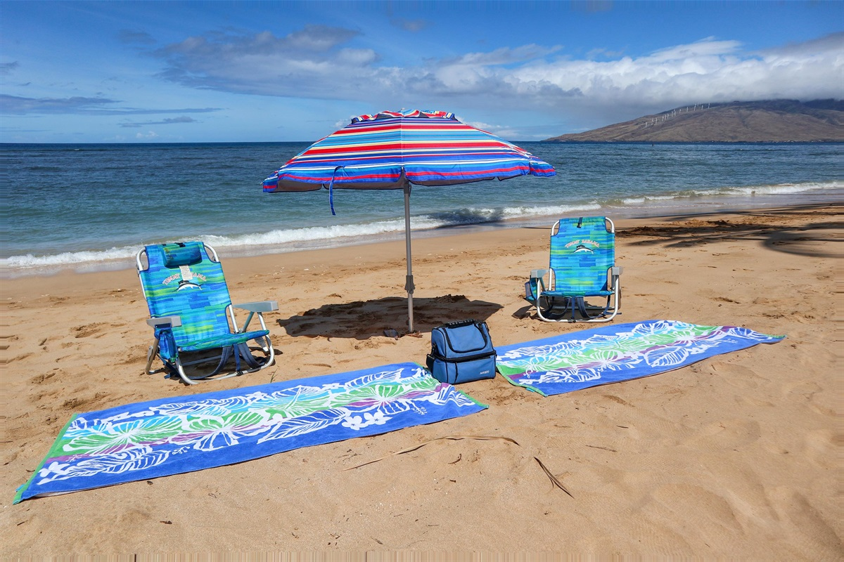 Umbrella, chairs, cooler and beach towels included