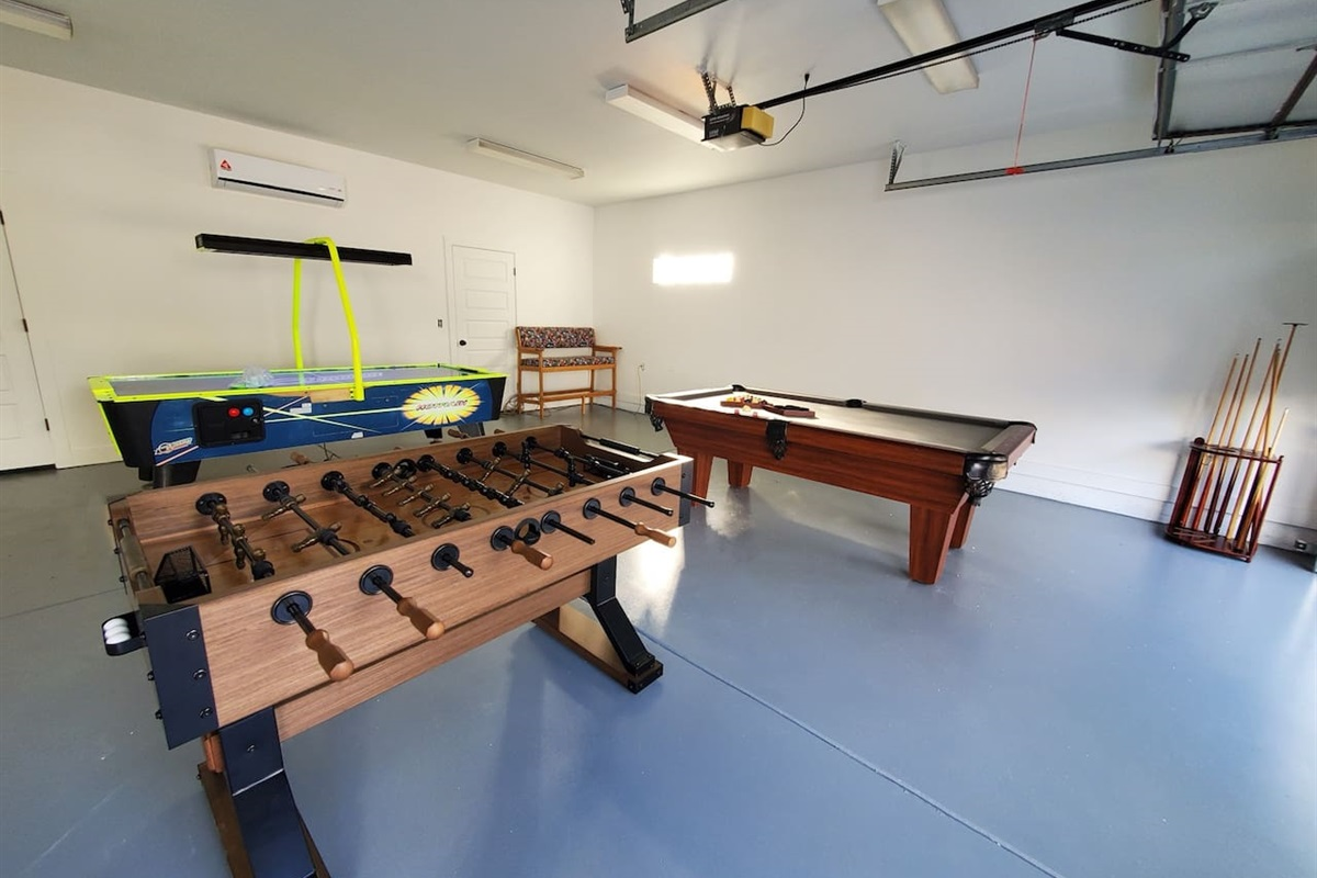 Game room with pool table, air hockey and Foosball table.