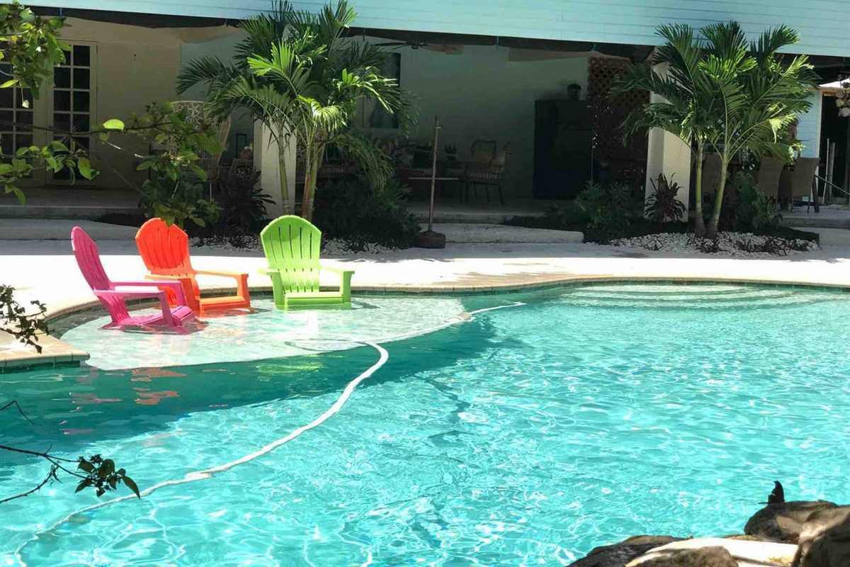 LARGE POOL WITH WATERFALL AND SLIDE.  FUN FOR EVERYONE.  SUNBATH ON THE SUNDECK, SWIM LAPS, GO DOWN THE POOL SLIDE. DO IT ALL.