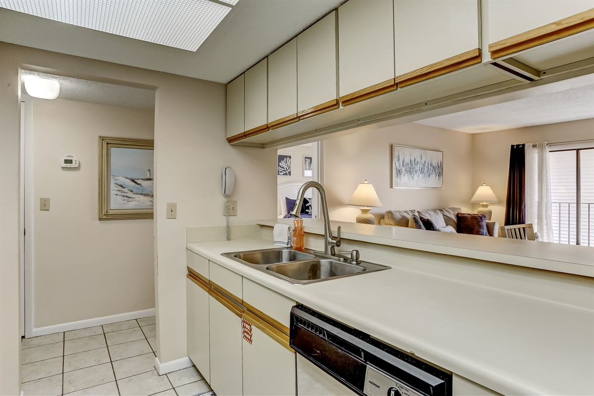 Kitchen Opens to Living and Dining Area