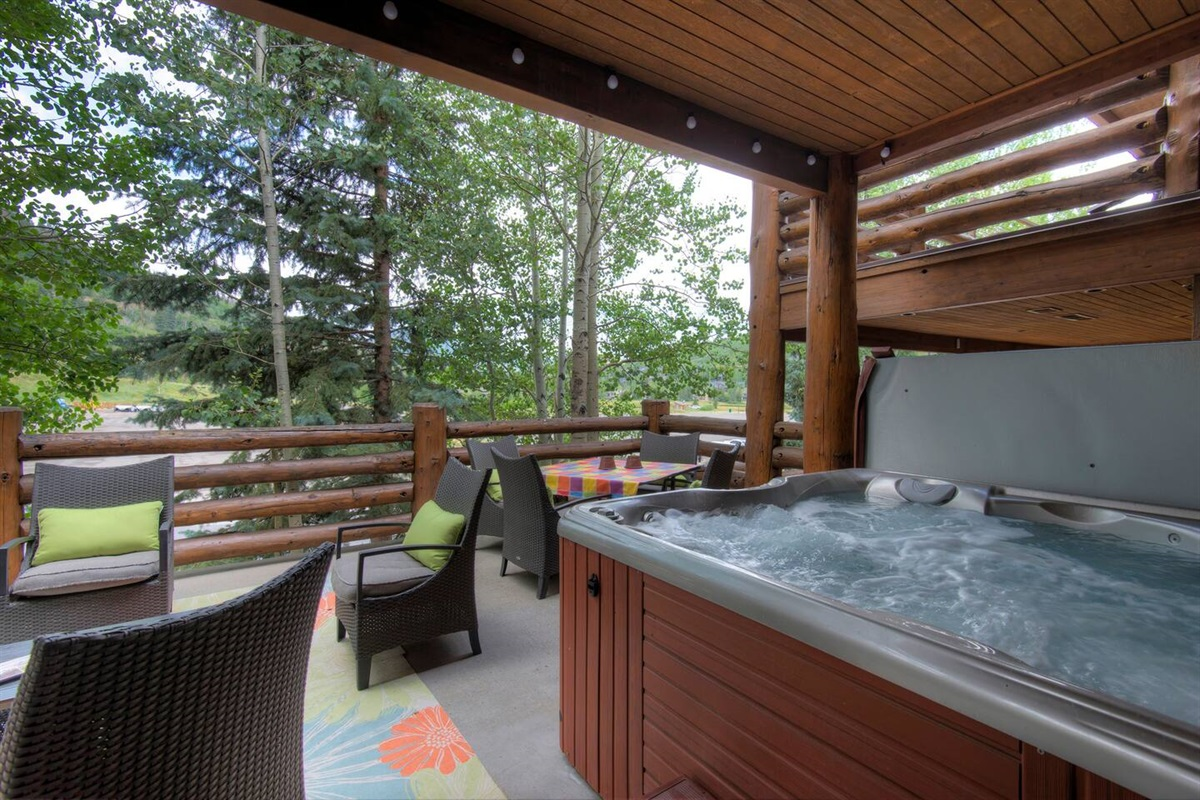 Private deck - hot tub, dining, BBQ, comfortable seating area