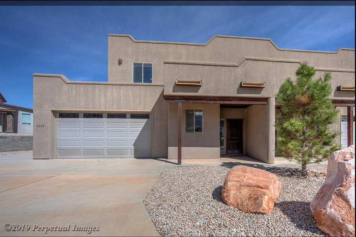 Front of home, oversized 2-car garage and RV parking
