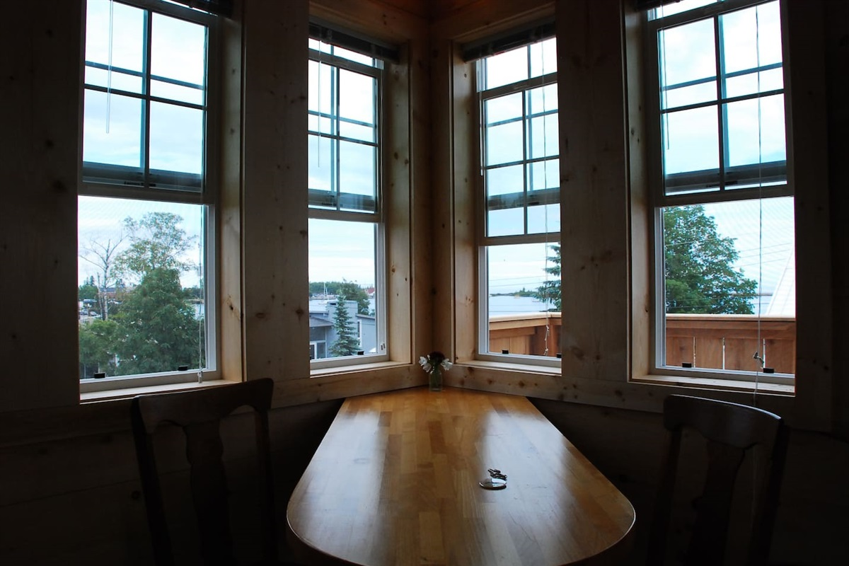 The view toward the harbor. Built in solid birch table, hardwood floors. With so many windows this studio apartment is a very special space.